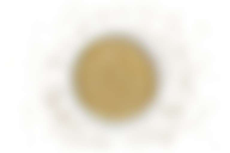 Белая плошка с просом для иллюстрации милиумов